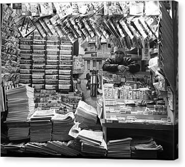 Canvas Print featuring the photograph Newsstand And Vendor by Dave Beckerman