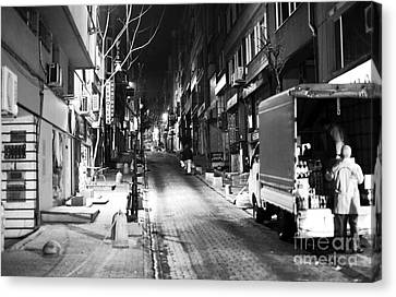 Night Delivery In Istanbul Canvas Print by John Rizzuto