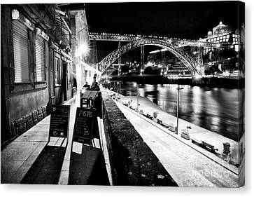 Night Dining In Porto Canvas Print by John Rizzuto