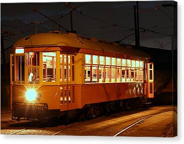 Canvas Print featuring the photograph Night Trolley by Jim Poulos