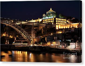 Nighttime In Porto Canvas Print by John Rizzuto