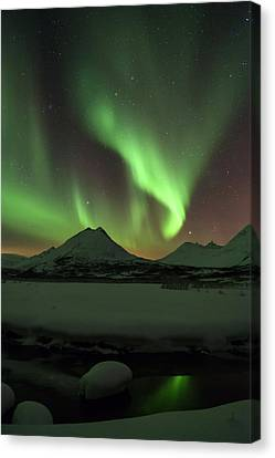 Northern Lights Over Frozen Lake Troms Canvas Print by Sandra Schaenzer