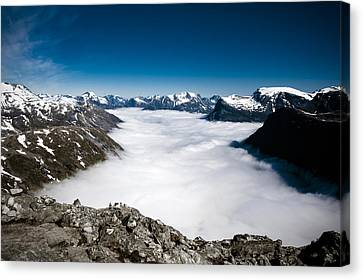 Norway In The Clouds Canvas Print by Bill Howard