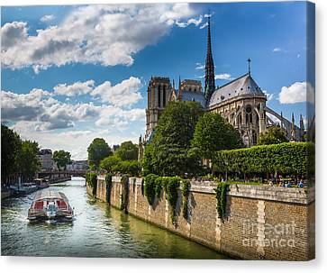 Notre Dame And The Seine River Canvas Print by Inge Johnsson