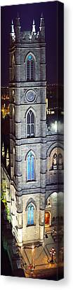 Notre Dame De Montreal At Night Canvas Print by Panoramic Images