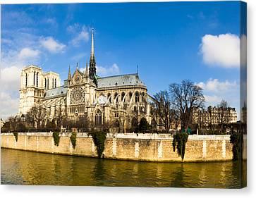 Notre Dame De Paris And The River Seine Canvas Print by Mark E Tisdale