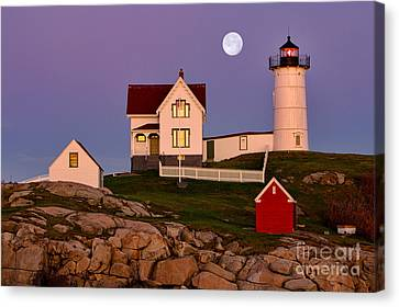 Nubble Lighthouse And Moon Canvas Print by Jerry Fornarotto