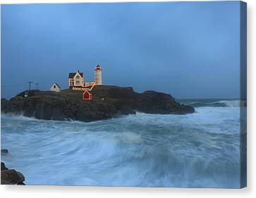 Nubble Lighthouse High Surf And Holiday Lights Canvas Print by John Burk
