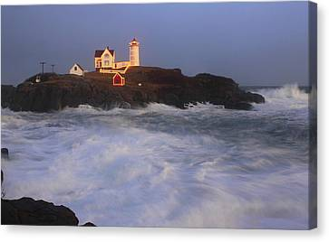 Nubble Lighthouse Canvas Print - Nubble Lighthouse Holiday Lights And High Surf by John Burk