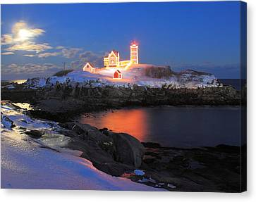 Nubble Lighthouse Canvas Print - Nubble Lighthouse Holiday Lights And Winter Moon by John Burk
