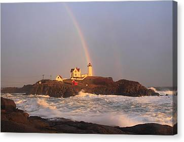 Nubble Lighthouse Rainbow And High Surf Canvas Print by John Burk