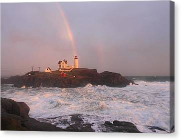 Nubble Lighthouse Rainbow And Surf At Sunset Canvas Print by John Burk