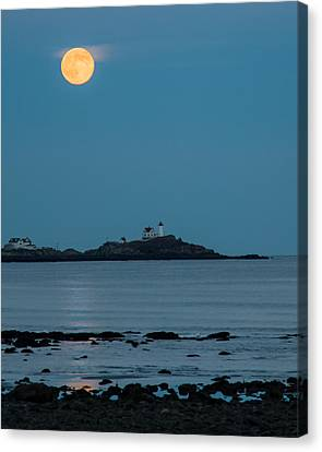 Nubble Lighthouse Under Full Moon Canvas Print by Jeff Folger