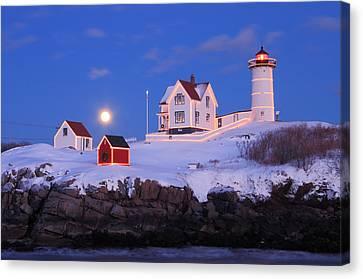 Nubble Lighthouse Winter Moon Canvas Print by John Burk