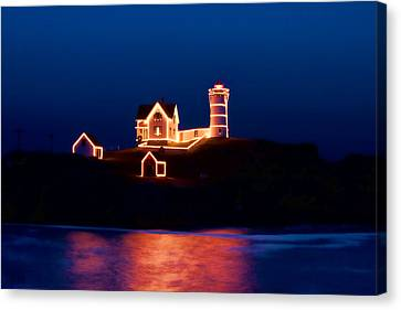 Solitude Canvas Print - Nubble Lighthouse With Christmas Lights by Jeff Folger