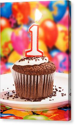 Canvas Print featuring the photograph Chocolate Cupcake With One Burning Candle by Vizual Studio