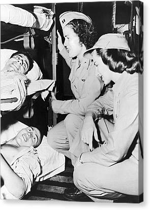 Nurses Comfort Wounded Canvas Print by Underwood Archives