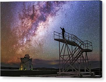 Observer Canvas Print - Observer Pointing At The Milky Way by Babak Tafreshi