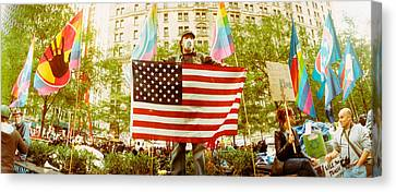 Occupy Wall Street Protester Holding Canvas Print by Panoramic Images