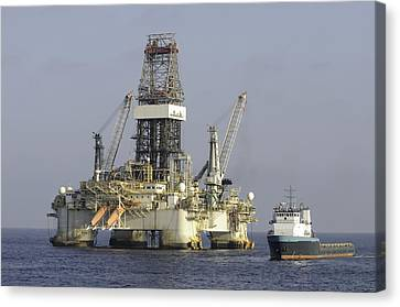 Canvas Print featuring the photograph Ocean Oil Rig With Supply Boat by Bradford Martin