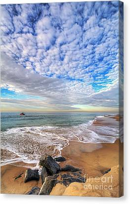 Ocean Touches The Sky Canvas Print by Eddie Yerkish