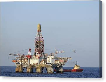 Canvas Print featuring the photograph Off Shore Oil Rig With Helicopter And Boat by Bradford Martin