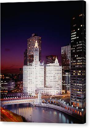Office Building Lit Up At Night Canvas Print by Panoramic Images