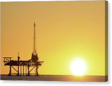 Canvas Print featuring the photograph Offshore Oil Rig And Sun by Bradford Martin