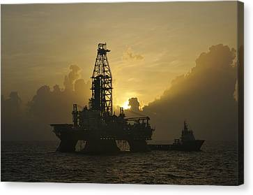 Canvas Print featuring the photograph Offshore Oil Rig With Sun And Clouds by Bradford Martin