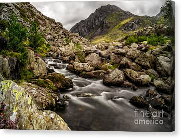 Ogwen River Canvas Print by Adrian Evans