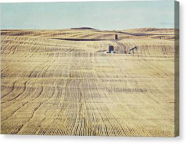 Oil And Gas Activity Among Canvas Print by Roberta Murray