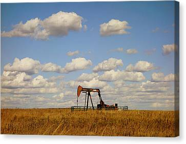 Oil Pump Jack On The Prairie Canvas Print