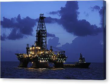 Canvas Print featuring the photograph Oil Rig And Vessel At Night by Bradford Martin