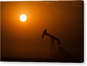 Oil Rig Pumping At Sunset Canvas Print by Connie Cooper-Edwards