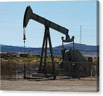 Oil Well  Pumper Canvas Print by Dany Lison