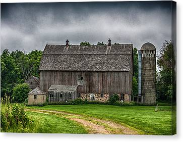 Old Barn On A Stormy Day Canvas Print by Paul Freidlund