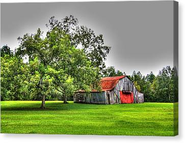 Canvas Print featuring the photograph Old Barn With Red Door by Lanita Williams