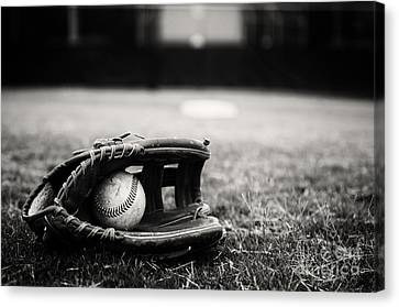 Old Baseball And Glove On Field Canvas Print