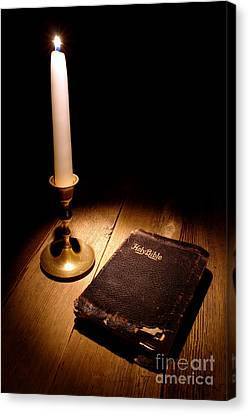 Christian Sacred Canvas Print - Old Bible And Candle by Olivier Le Queinec