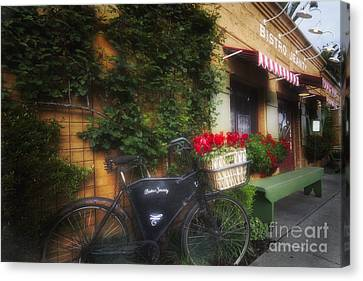 Old Bicycle At A French Bistro Canvas Print by George Oze