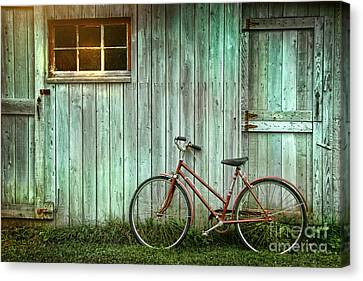 Old Bicycle Leaning Against Grungy Barn Canvas Print by Sandra Cunningham