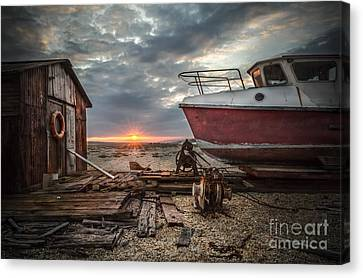 Old Boat At Sunset Canvas Print by Ivor Toms
