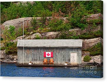 Old Boathouse With Two Muskoka Chairs Canvas Print by Les Palenik
