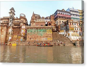 Old Buildings By The Ganges River Canvas Print by Ali Kabas