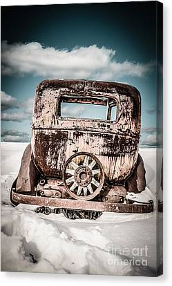 Old Car In The Snow Canvas Print by Edward Fielding