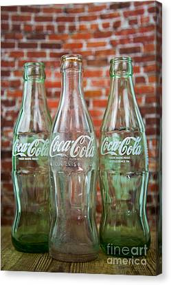 Old Cola Bottles Canvas Print by Serene Maisey