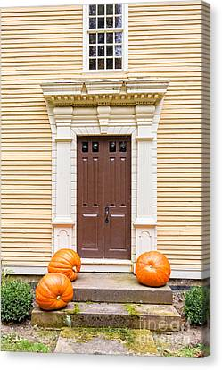 Old Colonial Era Front Door With Pumpkins Canvas Print by Edward Fielding