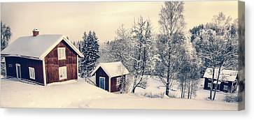 Canvas Print featuring the photograph Old Cottages In A Snowy Rural Landscape by Christian Lagereek