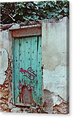 Old Door And Graffiti In Lorca Canvas Print by Sarah Loft