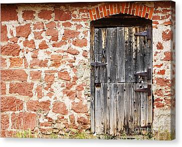 Canvas Print featuring the photograph Old Door In A Stone Wall by Lincoln Rogers